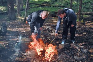 Stoking the fire on Bushcraft Course